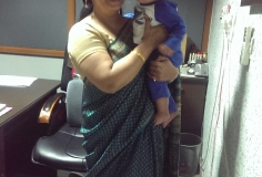 Dr. Nirmal with IVF baby - Low Cost IVF Treatment In Chandigarh